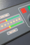 Fragment of modern tug ship control panel on the captain bridge. Selective focus, shallow DOF